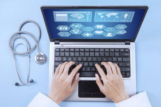 Doctor analyzing human illness on laptop